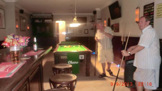 Cheers Sports & Food Bar : roy trying to play pool lol