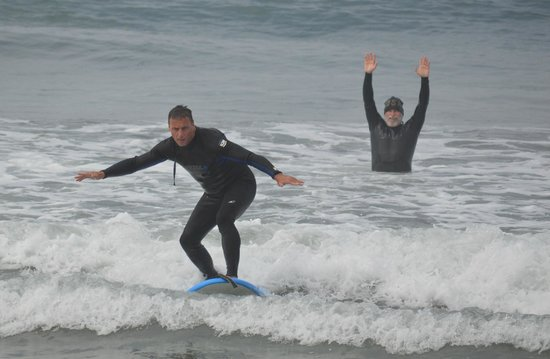 San Diego Surfing Academy Lessons: Up on the board after the first couple of tries!   San Diego Surfing Academy
