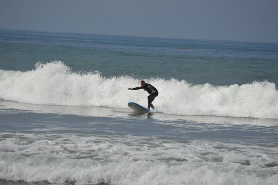 San Diego Surfing Academy Lessons: Riding some bigger waves on the first day, thanks to Coach Pat's instruction!