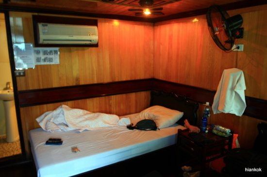 """Red River Hotel I: """"Air-con cannot be supported by the generators on board the boat,"""" the guide says. It is patheti"""