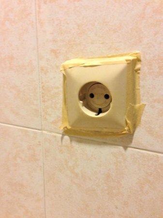 Laghawa Beach Inn: power outlet in the bathroom of Deluxe room