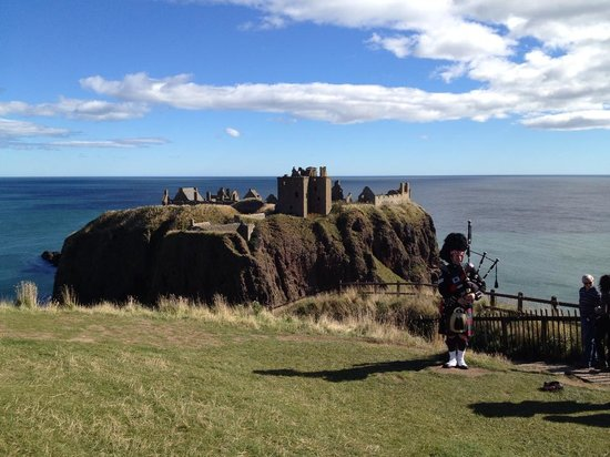 Dunnottar Castle and Piper