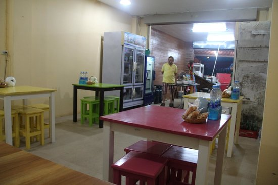 Ao Nang Boat Noodle: Dining area with colourful tables & chairs