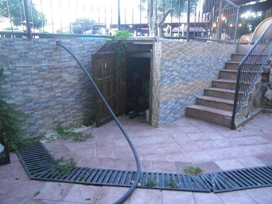 Seyir Village Hotel: This is the balcony with the pool equipment through the door that droned all night and the pipe
