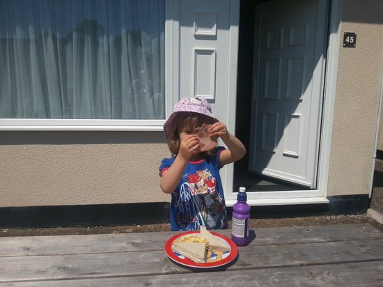Hazelwood Holiday Park: sitting outside the chalet