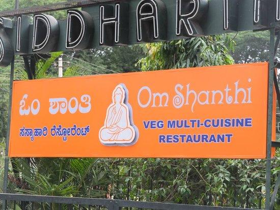 Om Shanthi: Enseigne