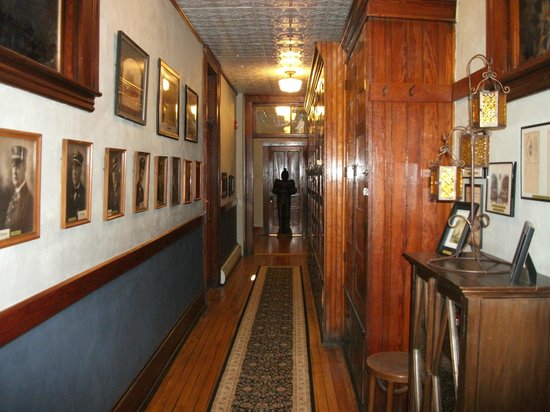Firehouse Inn: A hall to another room, original firemen's lockers on the right hand side.