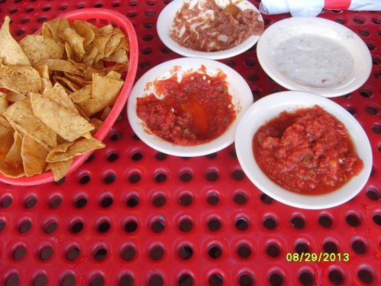 El Azteco: holes in table. salsa and chips