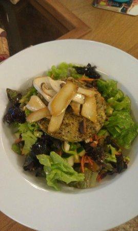 Cafe Carmen at the Tech Park: Homemade Vegan Burger with Hamakua Mushrooms over local greens