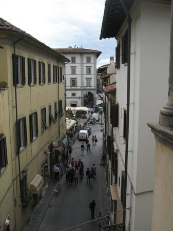 Botticelli Hotel: The view from our room along Via Rosina and to the market hall square.