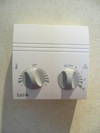 AR Diamante Beach SPA Hotel & Convention Centre: Bedroom air con controls.