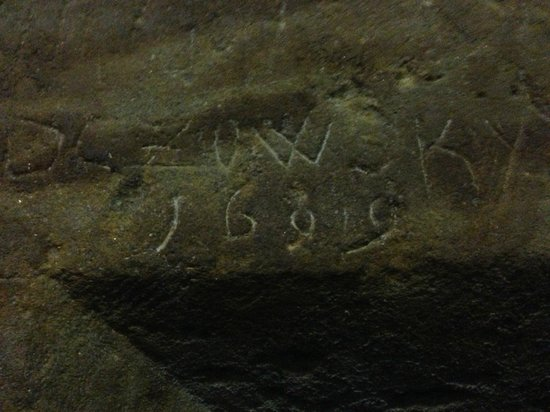 World War II in Prague Tour: engraving on a wall on an underground cave from 1699