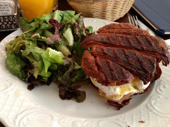 Kadosh - Since 1967: A Crunchy Salmon Croissant Sandwich with poached eggs.  With burned croissant.
