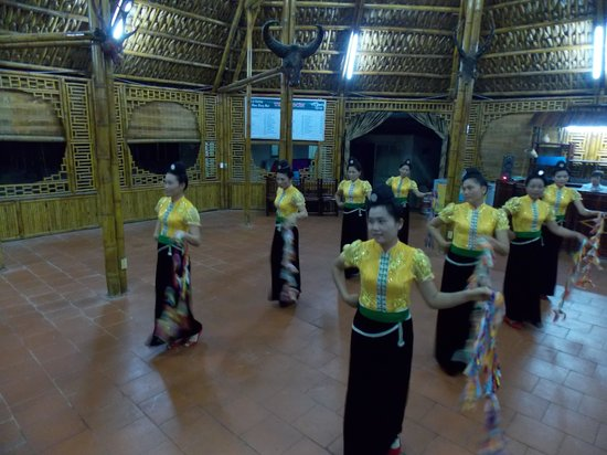 Muong Thanh Hotel: a group of 'Thai entertainers in the ethnic replica hut at the rear of the main building