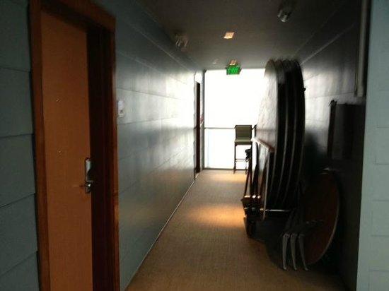 شايد هوتل: The hall next to our room, 205.  In the hall behind me were similar stacks of banquet chairs.