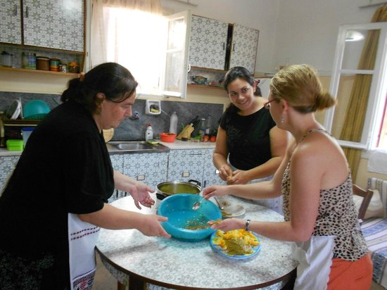 Cretan Traditional Cooking Lessons: Preparing stuffed wine leaves