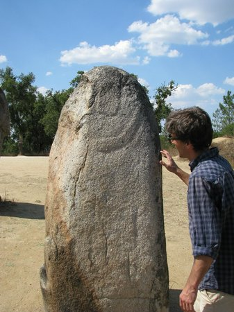 Ebora Megalithica Guided Tours: Mario in front of one of the monoliths in the Almendres Cromlech