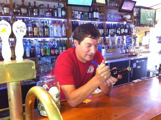 Estes Park Brewery: Owner, Tyler Lemirande autographs a bottle of Redrum Ale