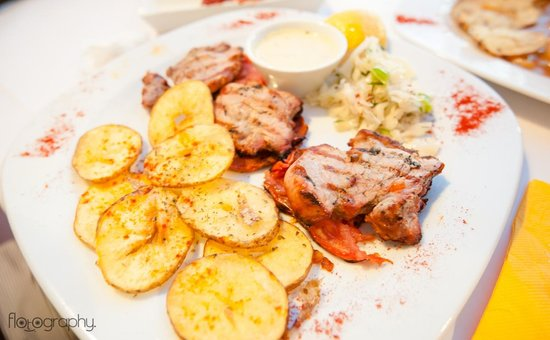 Mezzo Restaurant: Pork Fillet Grilled, with roasted tomato and feta cheese-ouza dip , thyme
