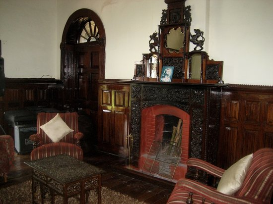 King's Cliff: Lounge with period fireplace
