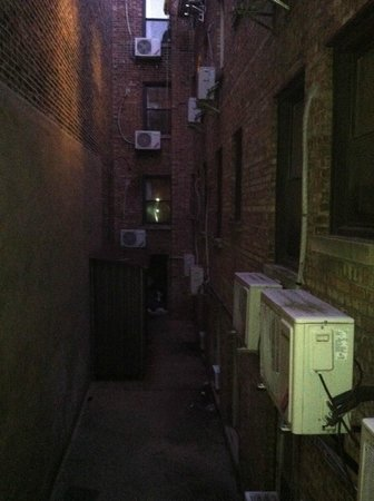 Chinatown Hotel: our window view of alley lol