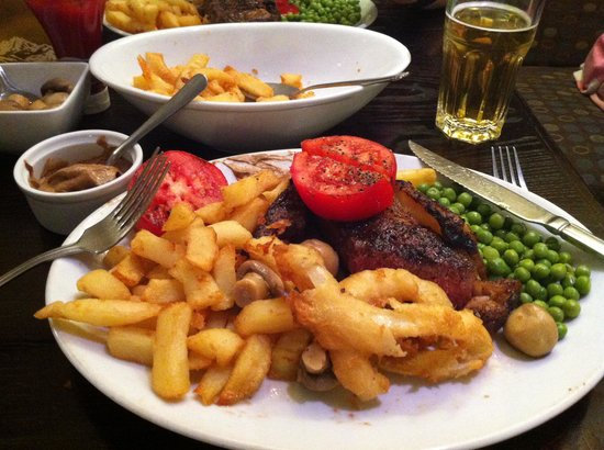 Steak and Omelette: Sirloin steak, chips, peas, tomatoes, mushrooms and onion rings