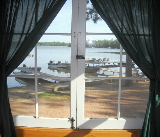 Cedaroma Lodge: View of the lake & docks from the dining room of cabin 1