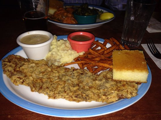 Memphis Mae's: Chicken Fried Steak with mashed potatoes and sweet potato fries!