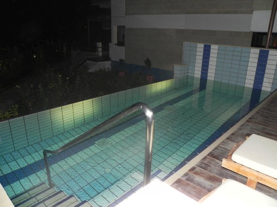 Constantinou Bros Asimina Suites Hotel: Night-time view of our room's private pool