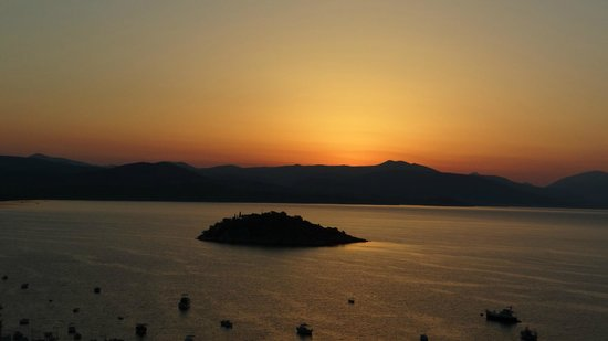 Hotel King Minos: Coucher de soleil sur la baie de Tolo.