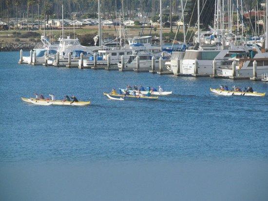 Ventura Harbor Village : Canoes in Ventura Harbor paddling past moored cabin cruisers and sailboats