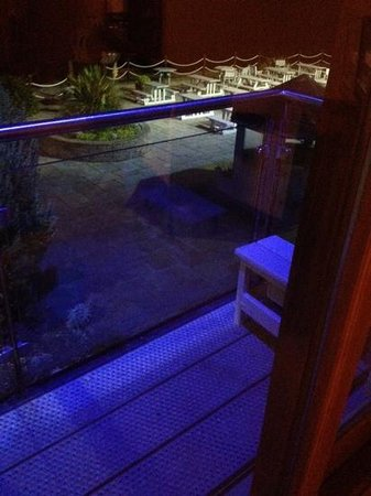 The Waterside House Hotel: night time garden view from room 121