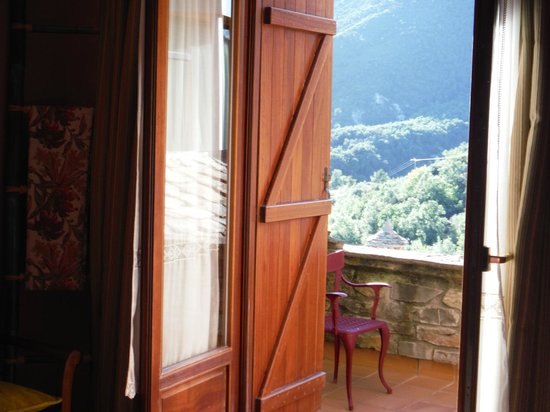 L'Abadia de Sieste : View out the shuttered windows to Terrace