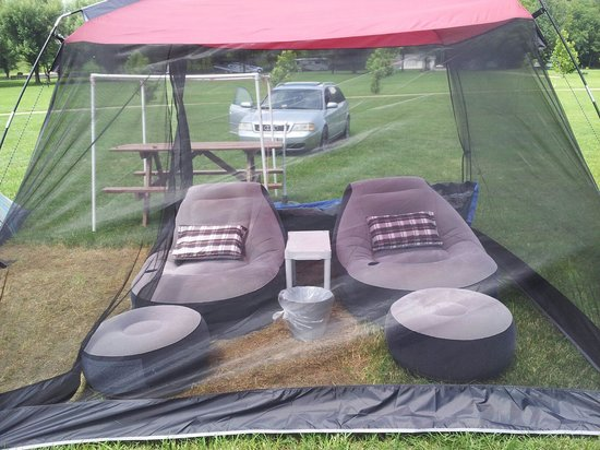 Watermelon Park Campground: screened in tent with lounge furniture