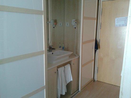 Guitart Central Park Aqua Resort : Sink set in wardrobe unit opposite toilet and shower rm. Sliding doors hide clothing storage her