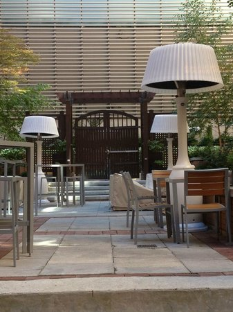 InterContinental Toronto Yorkville: Courtyard and lounge features oversized lampshade heaters that provide heat and light