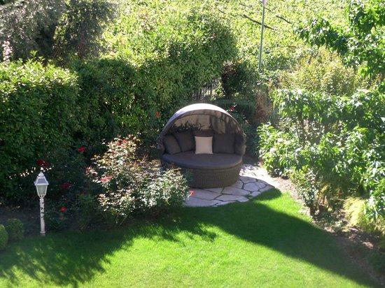 Hotel Pienzenau am Schlosspark: Sitzniche beim Swimmingpool Garten