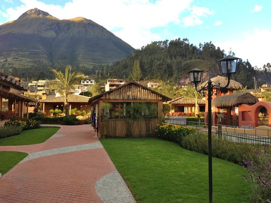 "Hosteria Cabanas del Lago: Looking ""N"" with log cabins and ""hut"" in forground"