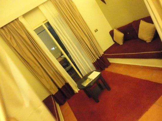 TUI Magic Life Sharm el Sheikh: Junior Suite - lounge area leading to balcony