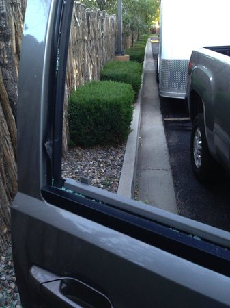 Hampton Inn Santa Fe: smashed window in parking lot