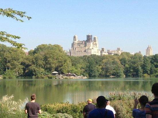 Real New York Tours: View of apartment building over the lake in Central Park
