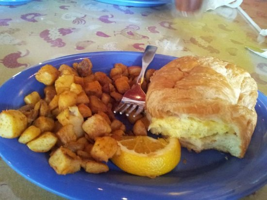 Over Easy Café: Potatoes and Omelet Sandwich