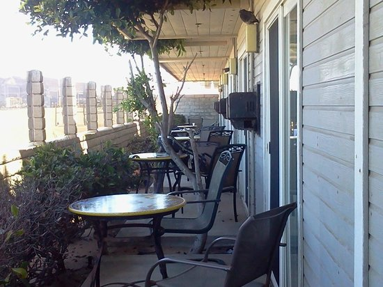 Inn on the Beach: not so private patios! your neighbor is inches from you