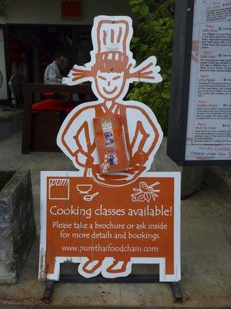 ปุ้ม ไทยเรสเตอรองท์ & คุกกิ้งสคูล: Pum's Cooking School sign on the main street in Patong.