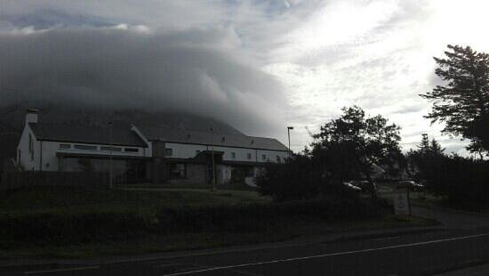 Errigal hostel at the foot of the cloud shrouded mountain