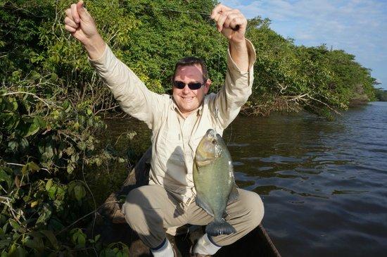 Caiman House Field Station: dug out canoe piranha fishing