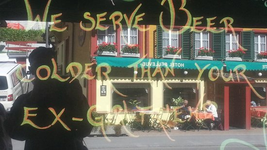 "Avocado Bar: Message in Window - ""We server beer colder than your ex ..."