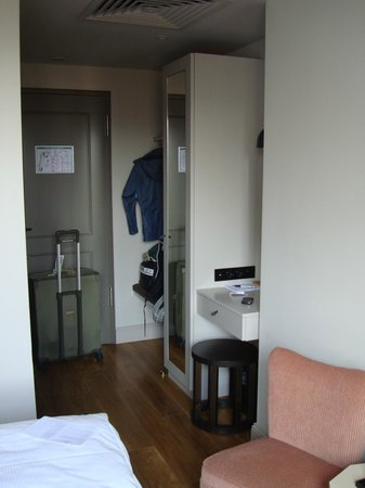 Monbijou Hotel: Entryway, closet, full length mirror, desk/vanity
