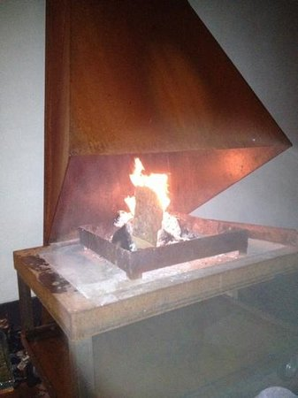 Hello I'm Local Boutique Hostel: fireplace in the patio