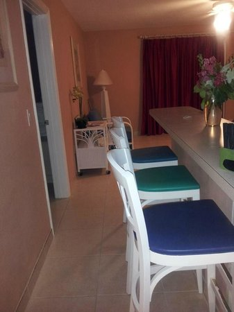 Carib Sands Beach Resort: Entry to bar and living room area of condo